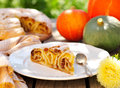 A piece of pumpkin vertuta traditional moldavian and romanian snail shaped pie Royalty Free Stock Photo