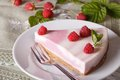 Piece of raspberry cheesecake close up on a plate horizontal delicious Stock Photos