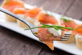 Piece of Salmon on a fork Stock Photography
