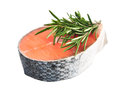 Piece of a salmon and rosemary on a white Stock Photo