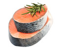 Piece of a salmon and rosemary on white Royalty Free Stock Photos