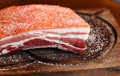 Piece of salted raw pork belly Royalty Free Stock Photos