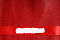 Piece scrap paper blank copy space on red leather background of white torn or ripped banner for text message Stock Photos