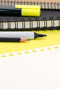 Piece of sheet notebook and markers on yellow table background Royalty Free Stock Photo