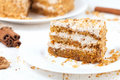 Piece of sliced gourmet carrot cake dessert with Royalty Free Stock Photo