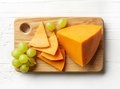 Piece and slices of cheddar cheese
