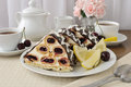 A piece of sponge cake dessert with cream with cherries in chocolate icing and coconut Royalty Free Stock Photos