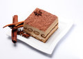 Piece of tiramisu on white plate Royalty Free Stock Photos