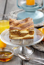 Piece of toffee and vanilla cake on transparent glass stand Royalty Free Stock Images