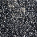 Pieces of broken bitumen asphalt composition as a background texture Royalty Free Stock Image