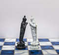A pieces of chess character on the board with a light a character represents strategy planning brave betrayal confrontation a and Stock Image