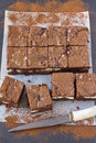 Pieces of chocolate cheesecake brownies on a baking paper Royalty Free Stock Photo