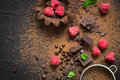 Pieces of chocolate, fresh raspberries and tartlets. Preparation. Food dessert background. Royalty Free Stock Photo