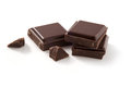 Pieces of chocolate on white a few isolated background cleaned and retouched photo clipping path included Stock Photography