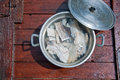 Pieces of codfish put nel acqua ready to be cooked iron Stock Images
