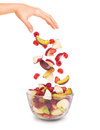 Pieces of fruit falling in a glass bowl Royalty Free Stock Photo