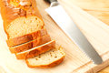 Pieces homemade banana bread knife cutting board Royalty Free Stock Images