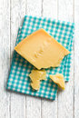 Pieces of italian hard cheese on a wooden table the Royalty Free Stock Image