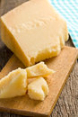 Pieces of italian hard cheese on a wooden table the Royalty Free Stock Photo