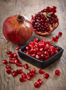 Pieces of pomegranate fruit on wooden table Royalty Free Stock Photo