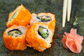 Pieces of sushi roll on nori Stock Photo