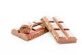 Pieces of tile porous milk chocolate on white background Stock Photo