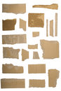 Pieces of torn brown corrugated cardboard Stock Photography