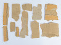 Pieces of torn brown corrugated cardboard Stock Image