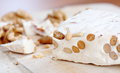Pieces of turkish delight nougat with nuts on desk Royalty Free Stock Photos