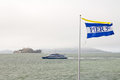 Pier 39 flag and alcatraz Stock Photography