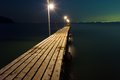 Pier Against Dark Sea Lizenzfreies Stockfoto