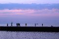 The pier along lake michigan this evening scene was awash with wonderful colors of lavender pink and blue in dusky sky was at rest Royalty Free Stock Photos