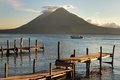 Pier on the atitlan lake in guatemala at sunset Royalty Free Stock Photos
