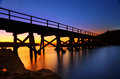 The pier bridge to bare island silhouetted botany bay auistralia Royalty Free Stock Photo