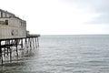 Pier on choppy sea in aberystwyth wales uk Royalty Free Stock Photography