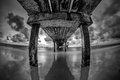 Pier clearwater florida black and white image under in taken with fisheye wide angle lens long exposure Royalty Free Stock Images