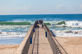 Pier fishermen sea blue waves concret Photos stock