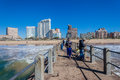 Pier fishermen sea durban hotels local at the end of concrete fishing on a clear blue morning venue beachfront with and apartment Stock Photo