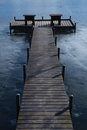 Pier on frozen lake Royalty Free Stock Images