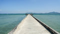 Pier at the indian ocean on the koh muk island harbor in thailand with blue sky and emerald waters Stock Image