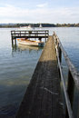 Pier at lake chiemsee with a boat Royalty Free Stock Photo
