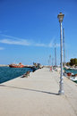 Pier with lanterns in the small port greece Royalty Free Stock Image