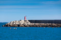 Pier with lighthouse at sagres portugal sunny day Stock Images