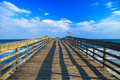 Pier over the atlantic meets blue sky and blue waters of ocean horizon myrtle beach state park myrtle beach south carolina Royalty Free Stock Photography