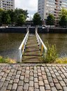 Pier over city river, background, wallpaper. Royalty Free Stock Photo