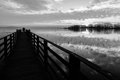Pier, people and reflections Royalty Free Stock Photo