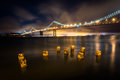 Pier pilings and the San Francisco - Oakland Bay Bridge Royalty Free Stock Photo