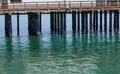 Pier Pillars into Green Sea Royalty Free Stock Photo