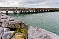 Pier rocky atlantic coast west ireland mountains background Royalty Free Stock Image