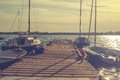 Pier with sailboats on the lake Royalty Free Stock Photo